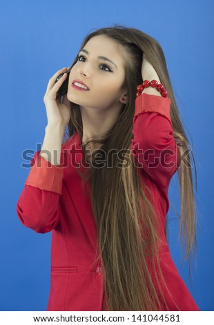 Young businesswoman talking on smart phone - stock photo