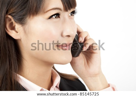 young businesswoman talking on the mobile phone - stock photo