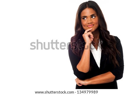 Young businesswoman thinking of something. Copy space area on image. - stock photo