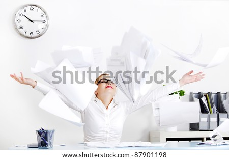 Young businesswoman throwing files in the air. - stock photo