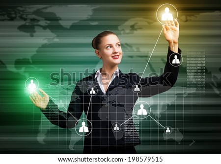 Young businesswoman touching icons of media screen - stock photo