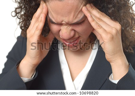 Young businesswoman trying hard to get rid of a headache - stock photo