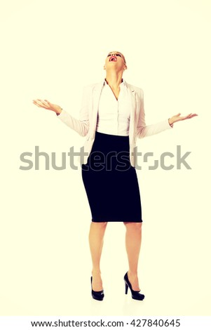 Young businesswoman trying to catch something - stock photo