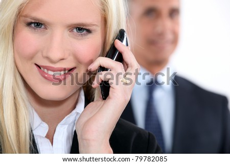 Young businesswoman using a cellphone - stock photo