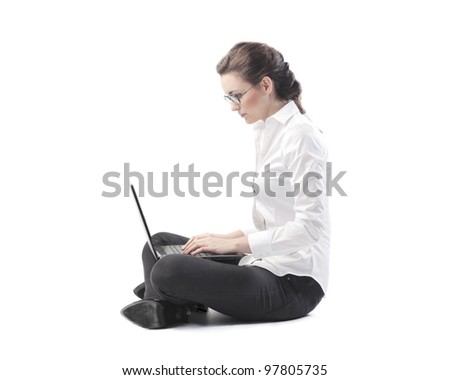 Young businesswoman using a laptop - stock photo