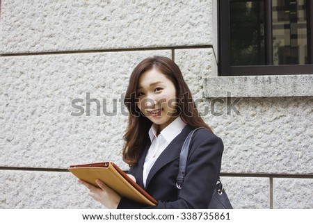 Young businesswoman using a tablet computer - stock photo
