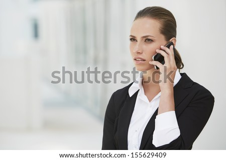 Young businesswoman using cellphone - stock photo