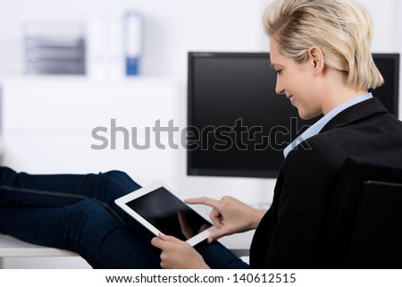 Young businesswoman using digital tablet office desk