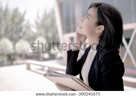 Young businesswoman using mobile phone - stock photo