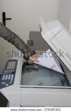 young businesswoman using  photocopy machine in office