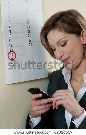 Young businesswoman waiting for a call or message on Valentine's day - stock photo