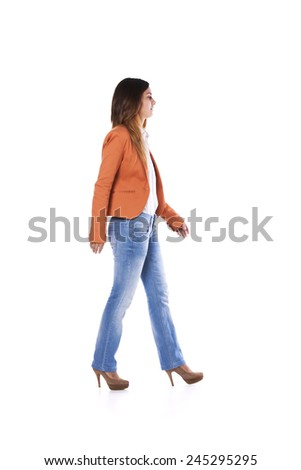 Young businesswoman walking isolated on white - stock photo