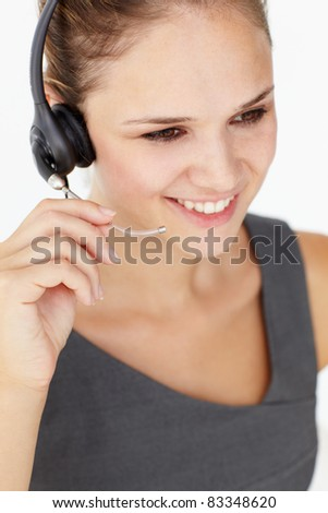 Young businesswoman wearing headset - stock photo