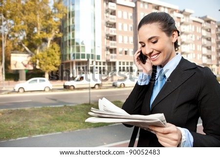 young  businesswoman well-dressed  on the phone, outdoor - stock photo