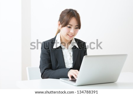 Young businesswoman who uses the computer - stock photo