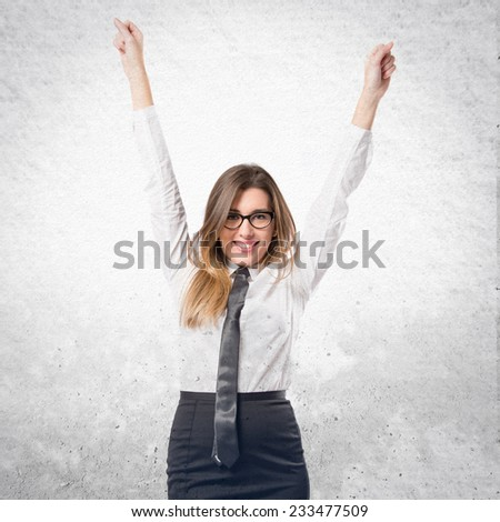 Young businesswoman winning on textured background  - stock photo