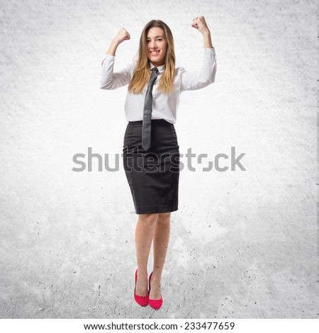 Young businesswoman winning on white background  - stock photo