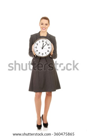 Young businesswoman with a clock.