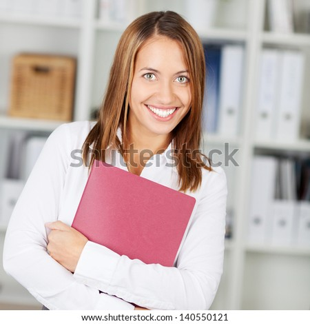 Young businesswoman with a curriculum vitae in her arms, looking for a job - stock photo