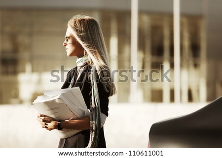 Young businesswoman with a papers - stock photo