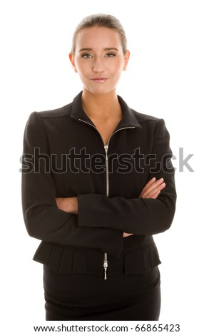 Young businesswoman with arms crossed - stock photo