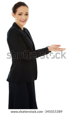 Young businesswoman with both hands opened.