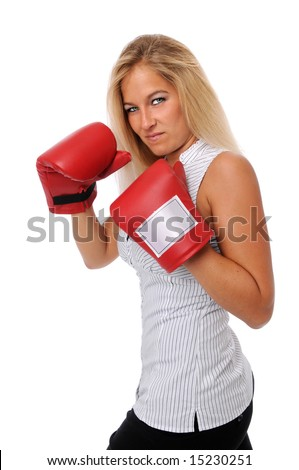 Young Businesswoman with boxing training gloves - stock photo