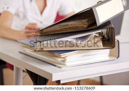 young businesswoman with file folder in the office - stock photo