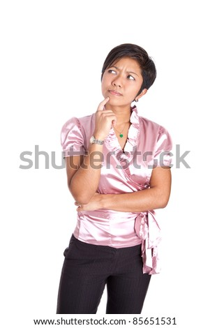 Young businesswoman with finger by face in thinking gesture - stock photo