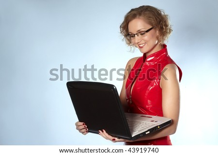 Young businesswoman with glass working at laptop