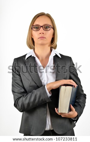 Young businesswoman with glasses looking up holding a book. Isolated on white - stock photo