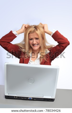 Young  businesswoman with laptop going crazy - stock photo