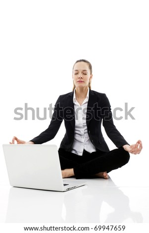 young businesswoman with laptop on the floor on white background studio