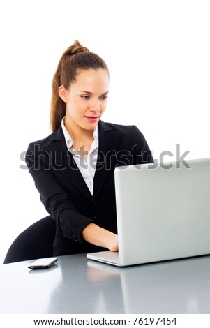 young businesswoman with laptop on white background studio - stock photo