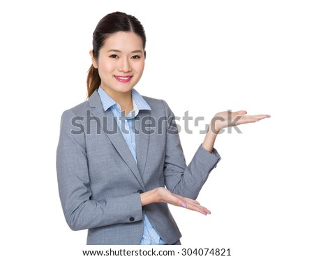 Young businesswoman with open hand palm