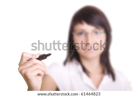 young businesswoman with pen in front of a virtual whiteboard. Focus on pencil. - stock photo