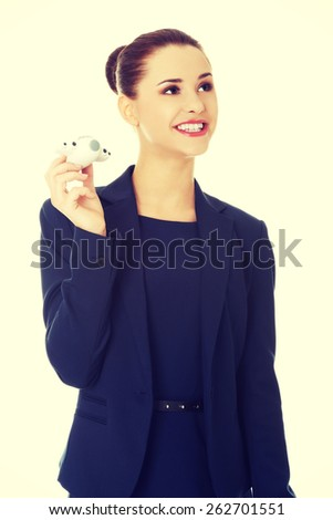 Young businesswoman with plane toy in hand