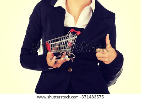 Young businesswoman with shopping trolley - stock photo