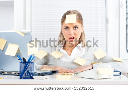 Young businesswoman with too much work to do,Overworked - stock photo