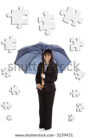 Young businesswoman with umbrella and puzzle pieces isolated in white background