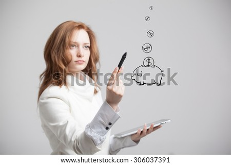 young businesswoman woman drawing a piggy Bank - stock photo