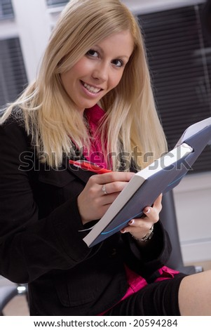 young businesswoman working at the office - stock photo