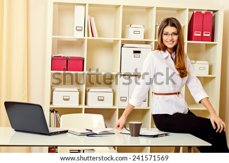 Young businesswoman working in a modern office. - stock photo