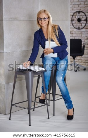 Young businesswoman working in temporary office. - stock photo