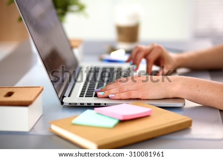 Young businesswoman working on a laptop - stock photo