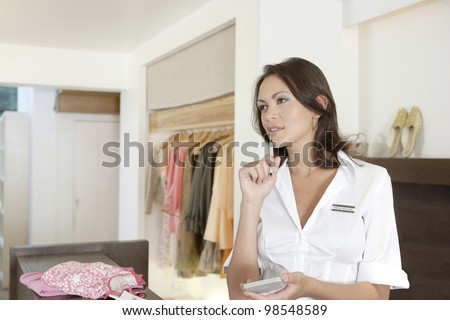 Young businesswoman working on her business finance. - stock photo