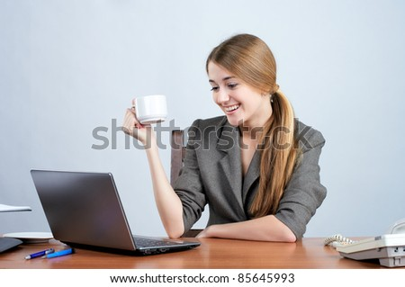 Young businesswoman working on laptop in the office - stock photo