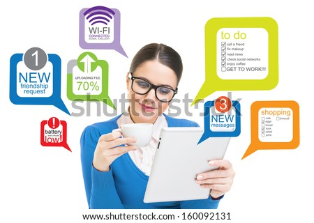 Young businesswoman working on tablet computer - stock photo