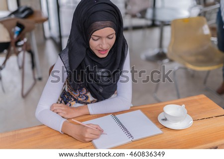 young businesswoman working while having a break on a cafe