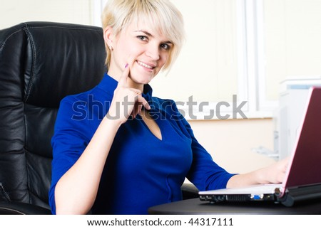 Young businesswoman working with notebook in office